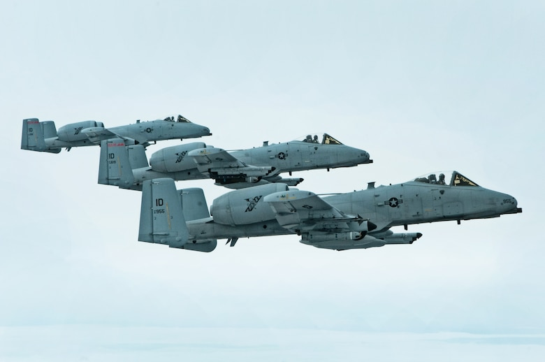 "Capt. Casey Peasley, flying the lead aircraft, with 1st Lt. Micha Stoddard, followed by Maj. Jay Labrum, from the 190th Fighter Squadron, Boise, Idaho, fly the mighty A-10 Thunderbolt II ""Warthog"" in an echelon formation on March 26. The three aircraft fly next to a KC-135 Stratotanker, for refueling enroute from the air combat exercise Green Flag East, Barksdale Air Force Base, La. (Air National Guard photo by Master Sgt. Becky Vanshur)"