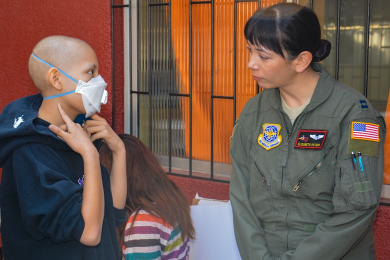 Capt. Elizabeth Peters, Aeromedical Evacuation Air Adviser for the 571st Mobility Support Advisory Squadron, speaks with a Chilean child while visiting local hospital in Santiago, Chile, March 28. Nearly 60 U.S. airmen are on a temporary duty assignment in Chile to participate in subject matter expert exchanges with Chilean air force counterparts and host static displays of the C-130 Hercules and F-16 Fighting Falcon at the FIDAE Air Show March 25 to 30.  Participants in the visit met with more than 20 children at the hospital receiving long-term care and spent time coloring, building small airplanes and playing. (U.S. Air Force photo by Capt. Justin Brockhoff/Released)