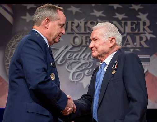 Air Force Chief of Staff Gen. Mark A. Welsh III presented the Prisoner of War Medal to Staff Sgt. John Fox during a ceremony April 30, 2014, in the Pentagon. Fox and his fellow crew members were shot down flying missions over Germany and were held in a prison camp in Wauwilermoos, Switzerland. The Airmen were denied their POW status for many years, until then Acting Secretary of the Air Force Eric Fanning authorized the medal for 143 Army Air Corps aviators in October of last year. (U.S. Air Force photo/Jim Varhegyi)