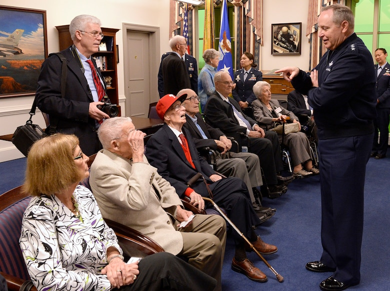 Air Force Chief of Staff Gen. Mark A. Welsh III (right) hosted an office call for Army Air Corps veterans and family members before presenting them with the Prisoner of War Medal during a ceremony April 30, 2014, in the Pentagon, Washington, D.C. The nine aviators served in World War II as bomber crew members and were shot down flying missions over Germany and were held in a prison camp in Wauwilermoos, Switzerland. U.S. Army Maj. Dwight Mears, whose grandfather Lt. George Mears, who was also held at the prison, fought diligently for 15 years to get the men recognized as POWs. (U.S. Air Force photo/Andy Morataya)