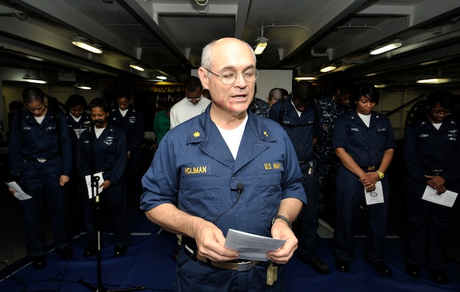 Lt. Cmdr. William Holiman, a chaplain aboard the aircraft carrier USS Harry S. Truman (CVN 75), leads the opening prayer for Sunday worship service. The command religious ministry department provides weekly worship services for Sailors and Marines as well as bible study, choir rehearsals and operates the ships library. The Harry S. Truman Carrier Strike Group is supporting maritime security operations and theater security cooperation efforts in the U.S. 5th and 6th Fleet areas of responsibility. (U.S. Navy Photo by Mass Communication Specialist 2nd Class Kilho Park/Released)