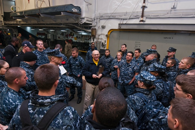 Cmdr. William Holiman, command chaplain aboard the amphibious assault ship USS Wasp (LHD 1), briefs Sailors in the hangar bay before they go ashore to help with relief efforts. More than 130 Sailors and Marines assigned to the amphibious assault ship USS Wasp (LHD 1) volunteered to help remove debris from the neighborhoods, roads, and alleys. Wasp, the amphibious transport dock USS San Antonio (LPD 17), and the dock landing ship USS Carter Hill (LSD 50) are positioned in New York Harbor to provide relief support to areas affected by Hurricane Sandy. (U.S. Navy photo by Mass Communication Specialist Seaman Markus Castaneda/Released)