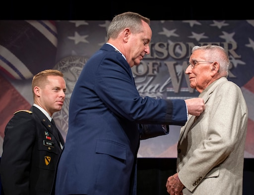 Air Force Chief of Staff Gen. Mark A. Welsh III presented the  Prisoner of War Medal to 1st Lt. Paul Gambaiana during a ceremony April 30, 2014, at the Pentagon. Gambaiana and eight other aviators, all bomber crew members, were shot down flying missions over Germany and were held in a prison camp in Wauwilermoos, Switzerland. The men were originally denied POW status. Then Acting Secretary of the Air Force Eric Fanning authorized the medal for 143 Army Air Corps Airmen in October 2013. (U.S. Air Force photo/Jim Varhegyi)