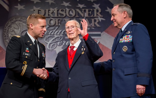Air Force Chief of Staff Gen. Mark A. Welsh III (right) presented the Prisoner of War medal to 1st Lt. James Mahon April 30, 2014, during a ceremony in the Pentagon. Mahon and eight other aviators, all bomber crew members, were shot down flying missions over Germany and were held in a prison camp in Wauwilermoos, Switzerland. Then Acting Secretary of the Air Force Eric Fanning authorized the medal for 143 Army Air Corps aviators in October 2013, after the Airmen were denied the proper status for decades. (U.S. Air Force photo/Jim Varhegyi)