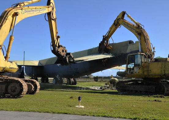 "A wing section of the ""Old-100"" static display B-52D Stratofortress at Arc Light Memorial Park is removed April 22, 2014 on Andersen Air Force Base, Guam. Although the B-52D was removed from the site, the vertical tail section was being preserved and will be part of a redesigned memorial.  (U.S. Air Force photo by Senior Airman Cierra Presentado/Released)"