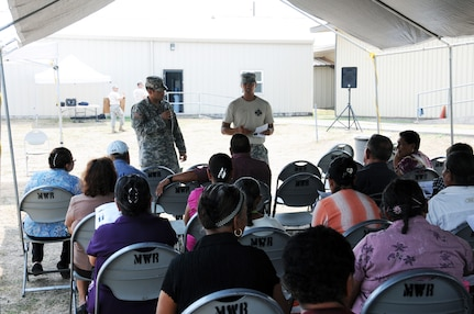 U. S. Army Capt. Allen Tangaan (right) with the assistance of his translator U. S. Army Staff Sgt. Ismael Arroyo, teaches a group of Honduran senior citizens the importance of exercising.  Joint Task Force-Bravo's Medical Element (MEDEL), with support from all Joint Task Force-Bravo commands, hosted the Soto Cano Air Base Senior Health Engagement providing valuable health and wellness information, a base tour, and some entertainment to 133 Honduran senior citizens from Cane, La Paz, April 30.  The group received health screenings and patient education related to blood pressure, blood sugar, exercise, muscle strength, balance and good oral hygiene as they age.  After the screenings and classes were finished, the group of senior citizens was able to turn back the hands of time and act young again as they were treated to dance lessons and the opportunity to dance with members from Joint Task Force-Bravo.  (Photo by U. S. Air National Guard Capt. Steven Stubbs)