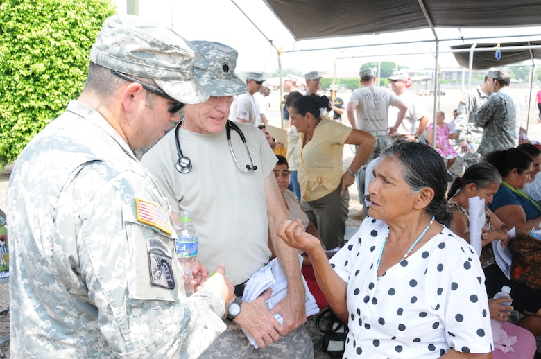 U. S. Army Lt. Col. Robert Walkup with the assistance of his translator U. S. Army Spc. William Baez, answers a Honduran woman's question about preventive health care.  Joint Task Force-Bravo's Medical Element (MEDEL), with support from all Joint Task Force-Bravo commands, hosted the Soto Cano Air Base Senior Health Engagement providing valuable health and wellness information, a base tour, and some entertainment to 133 Honduran senior citizens from Cane, La Paz, April 30.  The group received health screenings and patient education related to blood pressure, blood sugar, exercise, muscle strength, balance and good oral hygiene as they age.  After the screenings and classes were finished, the group of senior citizens was able to turn back the hands of time and act young again as they were treated to dance lessons and the opportunity to dance with members from Joint Task Force-Bravo.  (Photo by U. S. Air National Guard Capt. Steven Stubbs)