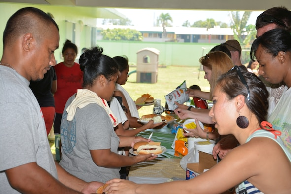 Members of the 36th Operations Support Squadron and family members serve barbecue meals to residents of the Guma San Jose Homeless Shelter in Dededo, Guam, April 12, 2014. The squadron volunteers assist shelter residents each quarter, providing meals as well as serving and cleaning. (U.S. Air Force courtesy photo/Released)