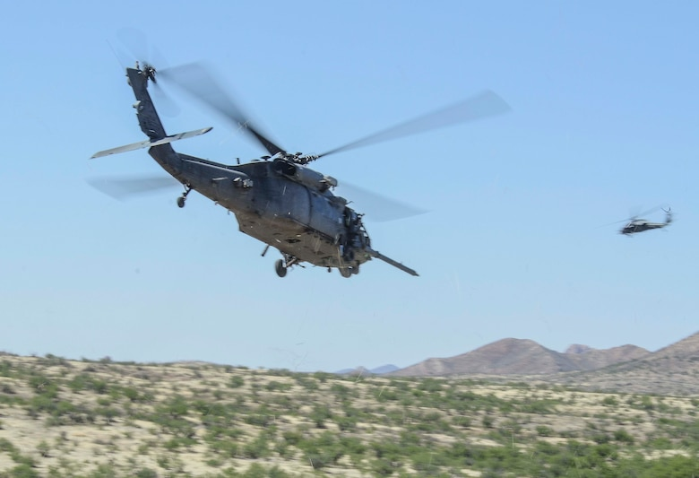 After extracting a downed pilot two HH-60's return to Davis-Monthan Air Force Base, during a Combat Search and Rescue Exercise in Southern Ariz., April 29, 2014. The main objective of this exercise was to effectively integrate communications across joint platforms to authenticate, locate and protect isolated personnel while successfully extracting them. (U.S. Air Force photo by Staff Sgt. Adam Grant/Released)