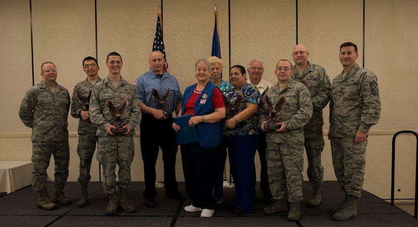 Col. Jeffrey DeVore, Joint Base Charleston commander (left), and Chief Master Sgt. Mark Bronson, 628th Air Base Wing command chief, stand with the 628th ABW Quarterly Awards winners May 1, 2014, at the Charleston Club on Joint Base Charleston – Air Base, S.C. The 628th ABW Quarterly Awards are held to recognize outstanding Airmen, noncommisioned officers, senior noncomissioned officers, company grade officers and civilians for their hard work and dedication. (U.S. Air Force photo/ Airman 1st Class Clayton Cupit)