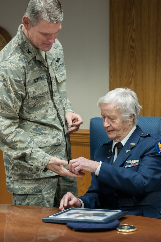 Col. Barry Gorter, commander of the 123rd Airlift Wing, presents Florence Shutsy Reynolds, 91, a former member of the Women Airforce Service Pilots corps during World War II, with a wing coin and certificate identifying her as an Honorary Wing Commander during her visit to the Kentucky Air National Guard Base in Louisville, Ky., March 22, 2014. The WASP program's primary focus was to reassign responsibility for flight operations over the United States from male to female pilots, freeing men to go to war. (U.S. Air National Guard photo by Staff Sgt. Vicky Spesard)