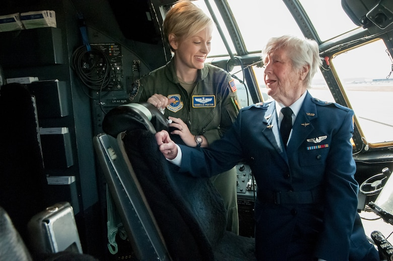 Capt. Danielle Parton, a pilot in the 123rd Airlift Wing, shares flying stories with Florence Shutsy Reynolds on the flight deck of a C-130 aircraft at the Kentucky Air National Guard Base in Louisville, Ky., March 22, 2014. Reynolds, a former pilot in the Women Airforce Service Pilots corps during World War II, was visiting the base as part of National Women's History Month. (U.S. Air National Guard photo by Staff Sgt. Vicky Spesard)
