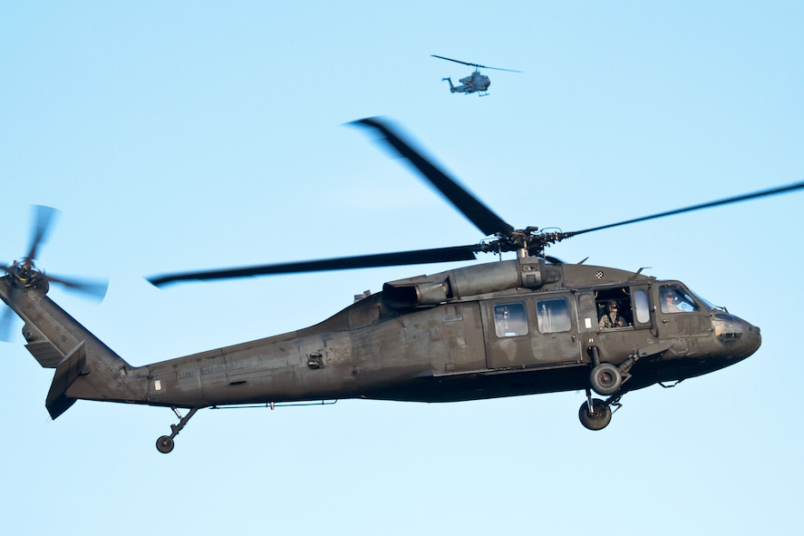 A U.S. Army UH-60 Black Hawk helicopter from the New Jersey Army National Guard's 1st Battalion, 150th Assault Helicopter Battalion provides over watch for a team of New Jersey Air National Guard tactical air control party (TACP) specialists while a AH-1W SuperCobra from Marine Light Attack Helicopter Squadron 773 provides armed recon in the background.  (U.S. Air National Guard photo by Tech. Sgt. Matt Hecht/Released)