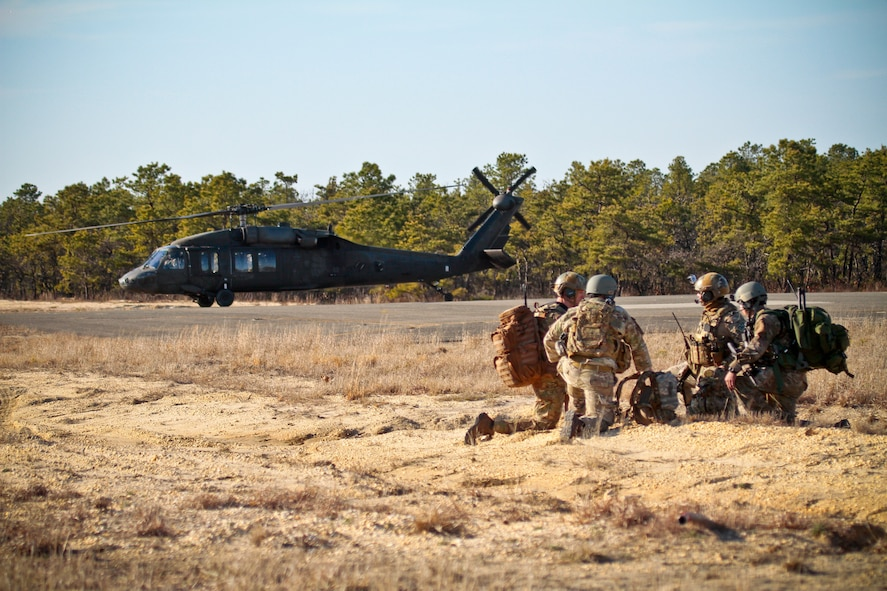 U.S. Air Force tactical air control party airmen from the New Jersey Air National Guard's 227th Air Support Operations Squadron stand by for transportation as a command a control UH-60 Black Hawk helicopter from the New Jersey Army National Guard's 1-150 Assault Helicopter Battalion stands by on April 10, 2014 at Warren Grove Gunnery Range, N.J. The New Jersey Army and Air National Guardsmen took part in a joint training exercise. (U.S. Air National Guard photo by Tech. Sgt. Matt Hecht/Released)