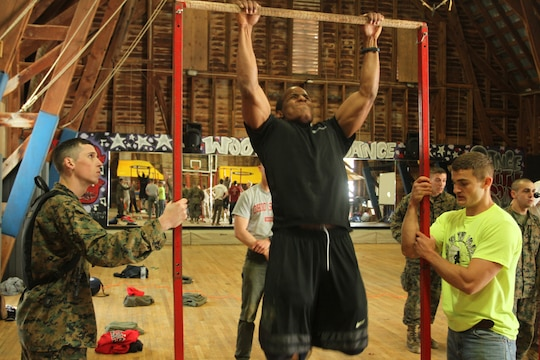 Malik Birks, a future Marine Corps officer candidate, does a set of pull-ups during a combat fitness course held during an Officer Candidates School preparatory weekend at Camp Woodward, Pa. April 25-27, 2014. The purpose of the weekend was to give the candidates a realistic view of how physically, mentally and emotionally demanding OCS will be. (U.S. Marine Corps photo by Sgt. Tyler Hlavac/Released)