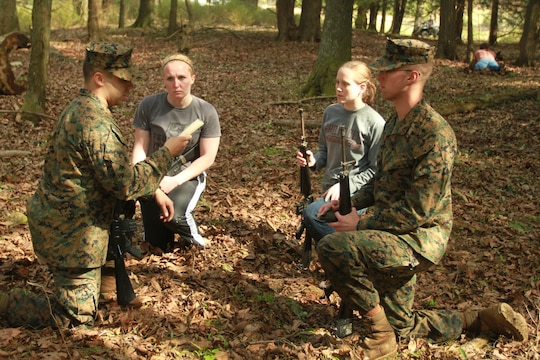 A group of future U.S. Marine Corps officer candidates plan a patrol during a small unit leadership class held during an Officer Candidates School preparatory weekend at Camp Woodward, Pa. April 25-27, 2014. The purpose of the weekend was to give the candidates a realistic view of how physically, mentally and emotionally demanding OCS will be. (U.S. Marine Corps photo by Sgt. Tyler Hlavac/Released)