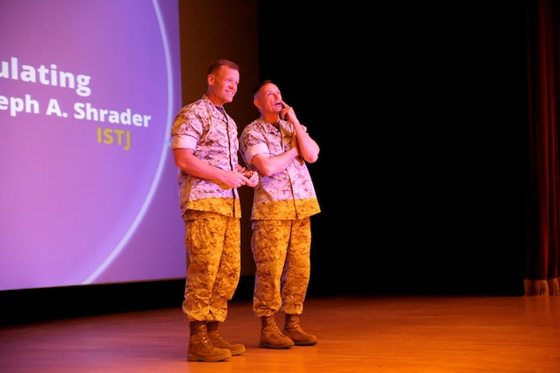 Brig. Gen. Frank Kelley (right), commander of Marine Corps Systems Command, introduces Col. Joseph Shrader at the April 30 MCSC Town Hall at Marine Corps Base Quantico, Va. Shrader has been selected for promotion to brigadier general and will assume command of MCSC in July.