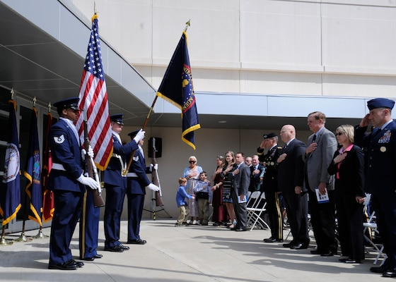 The family of the late Col. James N. Rowe as well as DIA leadership stand for the presentation of the colors during a building dedication ceremony in honor of Rowe at the DIA Field Support Activity Rivanna Station in Charlottesville, Va.