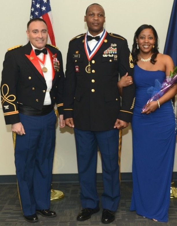 Col. Christopher Lestochi (left), Alaska District commander, was present for Master Sgt. Darnyell Parker's recognition of promotion to the rank of sergeant major at the Joint Chief Master Sergeant and Sergeant Major Recognition Ceremony Feb. 21 with Parker's wife, Michele, at Joint Base Elmendorf-Richardson, Alaska. Parker is currently the noncommissioned officer in charge of the district's Military Contingency Contracting Team that helps support the humanitarian assistance program in Southeast Asia.