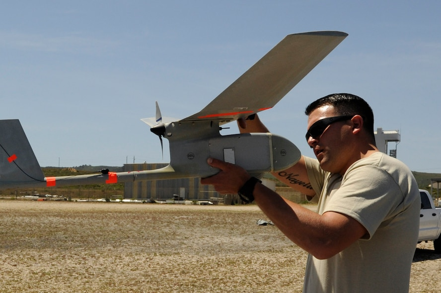 Staff Sgt. William Huster, 30th Security Forces Squadron noncommissioned officer in-charge of force protection and intelligence inspects a type of Unmanned Aerial Vehicle, known as Raven-B/DDL, April 30, Vandenberg Air Force Base, Calif. With an aim to enhance comprehensive base safety and security, the 30th Security Forces Squadron is bolstering its Small Unmanned Aircraft System program. (U.S. Air Force photo by Senior Airman Shane Phipps/Released)