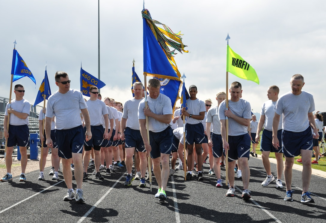Team Buckley members prepare at the start of a 2.5-mile WarFit formation run April 25, 2014, at the base track on Buckley Air Force Base, Colo. The workout included segments on base history and stops for anaerobic exercises. (U.S. Air Force photo by Staff Sgt. Nicholas Rau/Released)