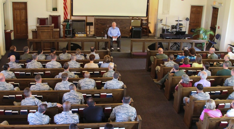 Pawel Lichter, a Holocaust survivor, speaks to the Airmen of 12th Air Force (Air Forces Southern) on his experiences during the Holocaust Day of Remembrance on Davis-Monthan AFB, Ariz., May 2, 2014.  Lichter joined a group of Holocaust survivors who recount their stories of survival during the German occupation of Europe, in hopes of informing younger generations.  (U.S. Air Force photo by Tech. Sgt. Heather R. Redman/Released)