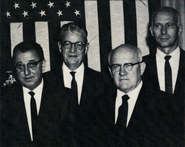 Dr. Carl Romney (far right), Air Force Technical Applications Center assistant technical director, is pictured with fellow AFTAC personnel (pictured left to right): Walter Singlevich, Gerald M. Leies and Doyle Northrup at an undetermined event in 1970. Northrup served as a technical director from July 1959 to 1972; Leies followed Northrup as technical director in 1974 until 1987 when the position was abolished.  He later became AFTAC's first chief scientist until his retirement in 1988.  Singlevich, a giant in the field of atomic energy and nuclear research, served at AFTAC's senior scientist throughout the 1980s until his death in 1992.  (Courtesy photo)
