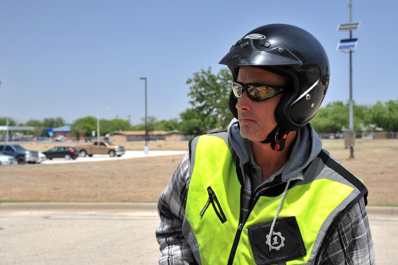 GOODFELLOW AIR FORCE BASE, Texas – Brian J. Davis, 17th Communications Squadron Communications Security manager, wears a certified helmet, sunglasses and vest at the multimedia center here April 30. Davis makes sure he wears the appropriate protective gear required to ride his motorcycle on a Defense Department installation. (U.S. Air Force photo/ Airman 1st Class Devin Boyer)