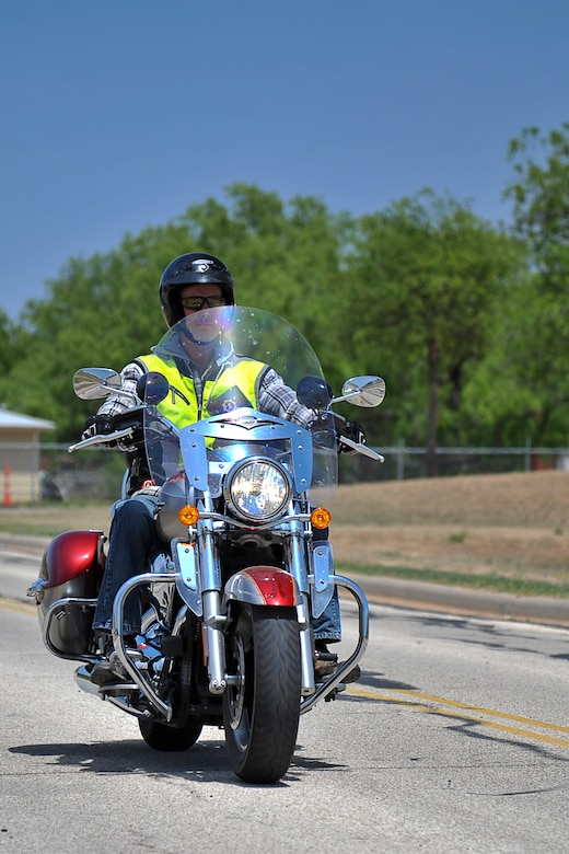 GOODFELLOW AIR FORCE BASE, Texas – Brian J. Davis, 17th Communications Squadron Communications Security manager, rides his motorcycle here April 30. Davis keeps his headlights on during the day, so other drivers on the road have a better chance of seeing him to avoid potential wrecks. (U.S. Air Force photo/ Airman 1st Class Devin Boyer)