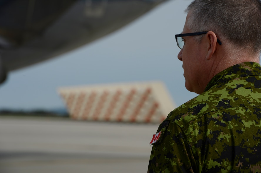 A Royal Canadian Air Force service member arrives on Spangdahlem Air Base, Germany, May 1, 2014. The Canadian Armed Forces will join Romania and other NATO allies currently operating in the region as the alliance's part of reassurance measures to Eastern and Central Europe.  (U.S. Air Force photo by Staff Sgt. Christopher Ruano/Released)