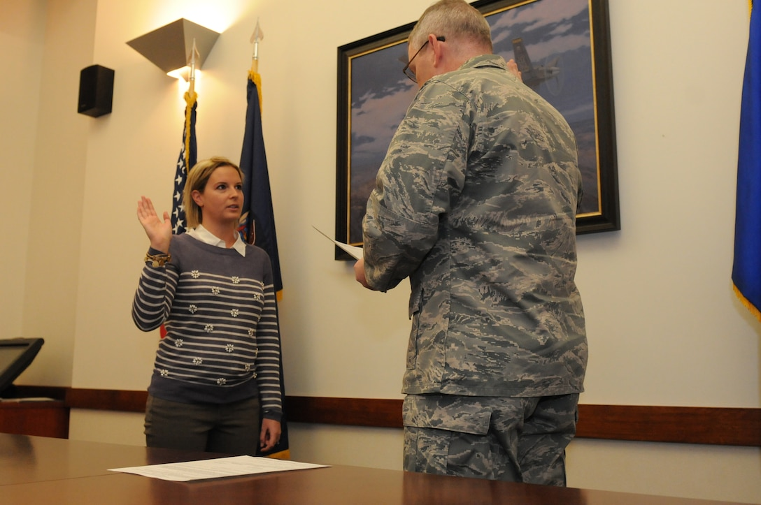Lt. Col. Brian Lauri, 174th Attack Wing Judge Advocate, swears Rachel Clark into the 174th Attack Wing in a ceremony held here on 2 May 2014. Clark will be taking over for Lauri as the new Judge Advocate. (New York Air National Guard Photo By Senior Duane Morgan)