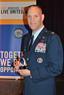Lt. Col. Edward Cook poses with The United Way of Central New York Exceptional Community Volunteer of the Year Award.