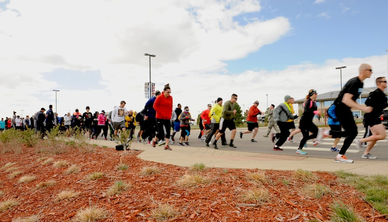 Team Buckley members begin the 2nd Annual Sexual Assault Prevention and Response 5K April 30, 2014, at the 460th Space Wing headquarters building on Buckley Air Force Base, Colo. The race brought service members, family and friends together to raise awareness for sexual assault prevention. (U.S. Air Force photo by Airman 1st Class Samantha Saulsbury/Released)