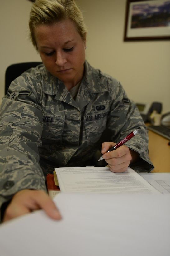 U.S. Air Force Airman 1st Class Tessa Boyea, 52nd Contracting Squadron contracting officer from Saratoga Springs, N.Y., reviews a contract for administrative discrepancies on Spangdahlem Air Base, Germany, April 24, 2014. Apart from the administrative work, Airmen sometimes go on site visits to ensure work is completed to the correct standards stated in the contract. (U.S. Air Force photo by Senior Airman Gustavo Castillo/Released)