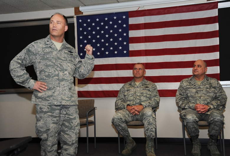 Oregon Air National Guard Commander Brig. Gen. Michael Stencel, left, acknowledges the accomplishments of Col. Michael Bieniewicz, center, and Col. Mark Crosby, right, during the Combat Operations Group (COG) Change of Command ceremony, May 3, 2014, Portland Air National Guard Base, Ore. Bieniewicz will begin a new assignment with counter drug at Joint Forces Headquarters, Salem, Ore., as Crosby becomes the new COG commander.  (Air National Guard photo by Tech. Sgt. John Hughel, 142nd Fighter Wing Public Affairs/Released)