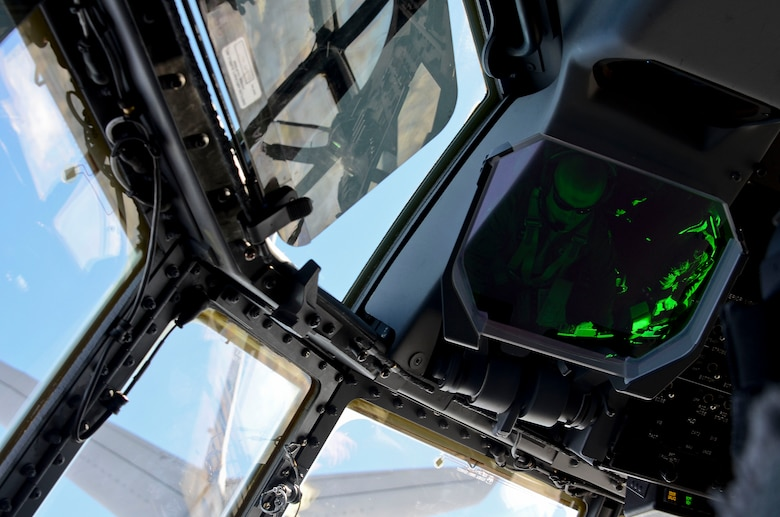 Maj. Nelson Bennet, a pilot assigned to the 79th Rescue Squadron, positions an HC-130J Combat King II behind a KC-135 Stratotanker for air-to-air refueling off the coast of Mexico May 03, 2014. Bennet and his crew transported U.S. Air Force pararescuemen from the 563rd Rescue Group to rescue two critically injured sailors 1,100 nautical miles off the coast of Mexico in the Pacific Ocean. The teams flew nearly 11 hours, requiring the in-air refueling, before the pararescue forces parachuted into the ocean along with two inflatable zodiac boats and medical equipment to deliver lifesaving care. The KC-135 was flown by Airmen from the Arizona Air National Guard's 161st Air Refueling Wing. (U.S. Air Force photo by Staff Sgt. Adam Grant/Released)