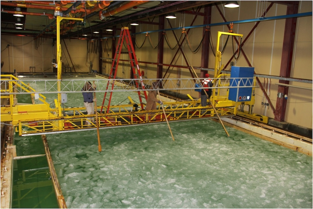 A view of the Ice Engineering Facility's Test Basin, including the personnel carriage assembly (yellow) for instrumentation, general monitoring, and measurement of the ice properties.