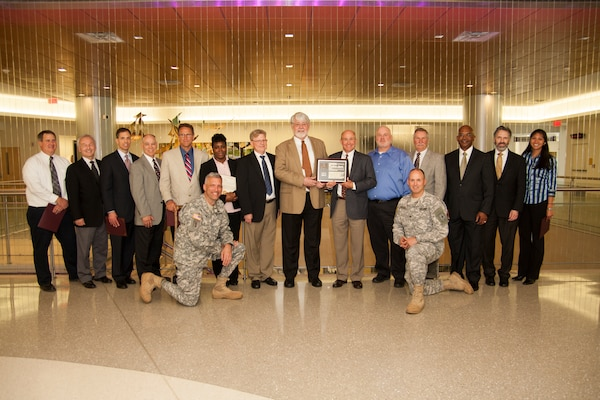 The Norfolk District's Fort Belvoir Community Hospital Project Delivery Team receives the U.S. Army Corps of Engineers' PDT of the year award for 2013. The team overcame tremendous hurdles as they oversaw construction of a more than $1 billion hospital during the Base Realignment and Closure 2005 process. (U.S. Army photo/Patrick Bloodgood)