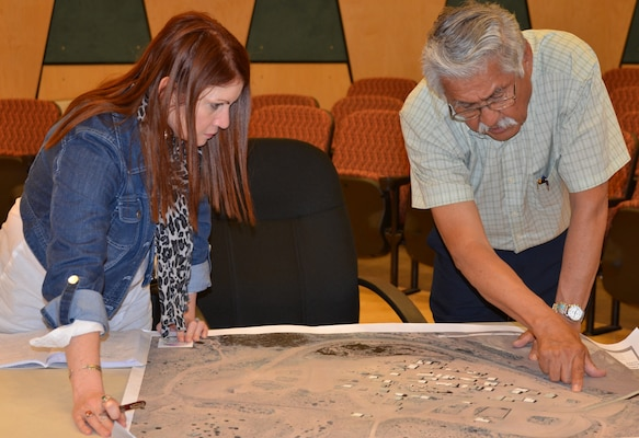 SANTA ANA PUEBLO, -- Lisa Morales, senior USACE tribal liaison, and Governor George Montoya, Pueblo of Santa Ana, discuss Tamaya Village, one of the Corps' ongoing projects with the pueblo.