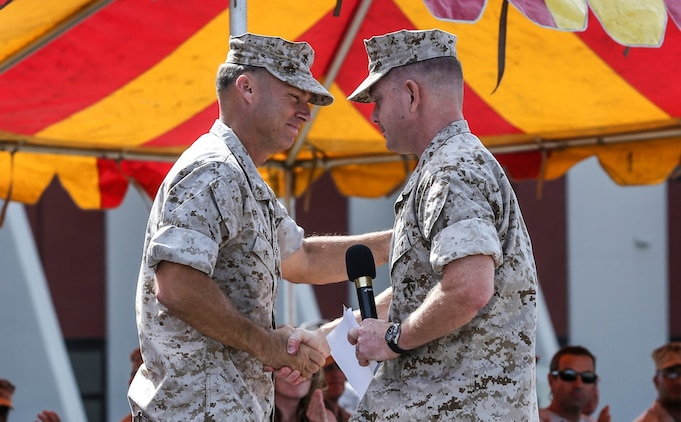 Lieutenant Col. John R. O'Neal, commanding officer, 15th Marine Expeditionary Unit, right, thanks and congratulates Lt. Col. William D. Wischmeyer, executive officer, 15th MEU, for his dedication to the Marine Corps during his retirement ceremony aboard Camp Pendleton, Calif., May 1, 2014. Wischmeyer, 48, is from Clay, S.D. (U.S. Marine Corps photo by Cpl. Emmanuel Ramos/Released)