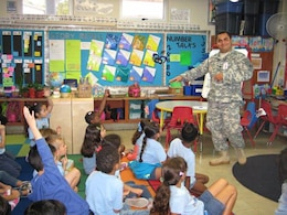 Capt. J.C. Cordon, deputy commander for the Antilles, was impressed by the questions asked by first grade students when he and fellow team members participated in an April 10 Science, Technology, Engineering and Math(STEM) event at the Antilles Elementary School, Fort Buchanan, Puerto Rico.