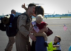 Capt. Aleksander Layne, 17th Airlift Squadron pilot, is met by his wife, Amy, and their two sons, Markus and Rex (far right) during the 17th AS Redeployment May 5, 2014, at Joint Base Charleston, S.C. During their two-month deployment to Southwest Asia, the squadron completed more than 800 sorties, logged in 2,381 flying hours and airlifted more than 28.5 million pounds of cargo and approximately 18,700 passengers. (U.S. Air Force photo/Staff Sgt. AJ Hyatt)