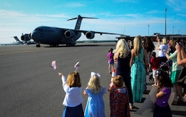 Family members and co-workers await the return of the 17th Airlift Squadron May 3, 2014, at Joint Base Charleston, S.C. The 17th AS is returning from a two-month deployment to Southwest Asia. (U.S. Air Force photo/Staff Sgt. AJ Hyatt)