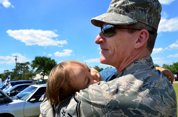 Master Sgt. Floyd Belanger, 919th Special Operations Medical Squadron, carries his sleeping son during Duke Field's Family Day event May 3.  The 919th Special Operations Wing sets aside a special day each year to show appreciation for its reservists and their family members. Events included music, sports, children's games, etc. (U.S. Air Force photo/Tech. Sgt. Cheryl L. Foster)