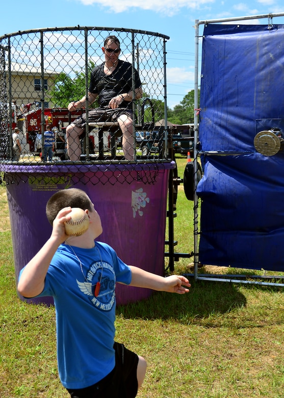 Major Jeffrey Powell, 919th Special Operations Maintenance Squadron, takes his turn sitting in the dunking booth during Duke Field's Family Day event May 3.  The 919th Special Operations Wing sets aside a special day each year to show appreciation for its reservists and their family members. Events included music, sports, children's games, etc. (U.S. Air Force photo/Tech. Sgt. Cheryl L. Foster)