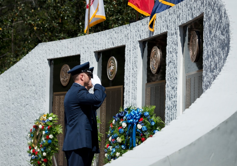Maj. Mark Fogle and Chief Master Sgt. Neil Jones salute the Memorial Wall after the names of fallen Air Force explosive ordnance disposal technicians were read during the 45th Annual EOD Memorial Ceremony May 3, at Eglin Air Force Base, Fla. Eight new names of Army and Marine EOD technicians, who lost their lives, were added to the wall this year.  The all-service total now stands at 306. (U.S. Air Force photo/Tech. Sgt. Sam King)