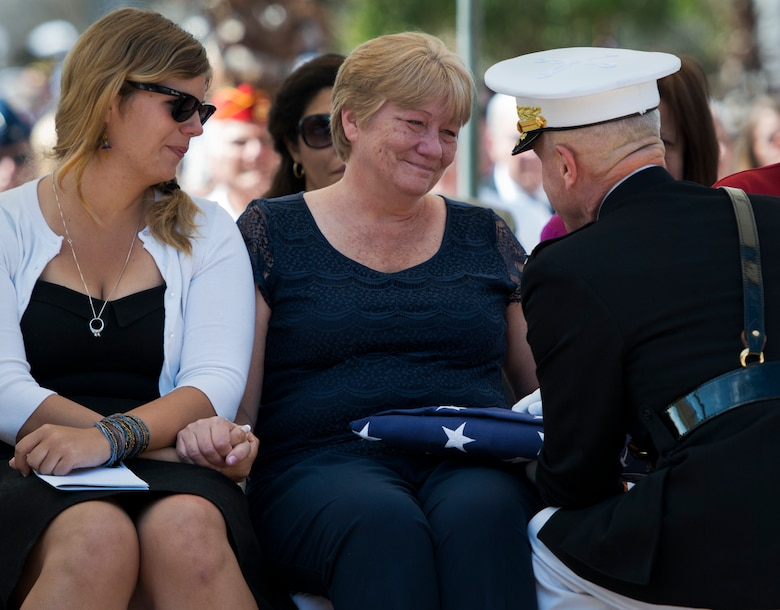 Monica Marsh, mother of Staff Sgt. Mathew Marsh, listens to Marine Corps Commandant Gen. Jim Amos during the 45th Annual Explosive Ordnance Disposal Memorial Ceremony May 3, at Eglin Air Force Base, Fla. Eight new names of Army and Marine EOD technicians, who lost their lives, were added to the Memorial Wall this year.  The all-service total now stands at 306. (U.S. Air Force photo/Tech. Sgt. Sam King)