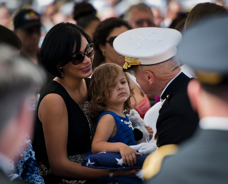 Violeta Mullins, widow of Gunnery Sgt. Greg Mullins, and their daughter Giovanna, speak with Marine Corps Commandant Gen. Jim Amos during the 45th Annual Explosive Ordnance Disposal Memorial Ceremony May 3, at Eglin Air Force Base, Fla. Eight new names of Army and Marine EOD technicians, who lost their lives, were added to the Memorial Wall this year.  The all-service total now stands at 306. (U.S. Air Force photo/Tech. Sgt. Sam King)