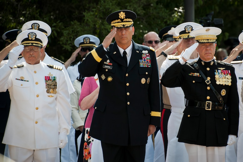 Capt. William Noel, Navy School EOD commandant, Army Chief of Staff Gen. Ray Odierno and Marine Corps Commandant Gen. Jim Amos salute during the presentation of the colors at the 45th Annual Explosive Ordnance Disposal Memorial Ceremony May 3, at Eglin Air Force Base, Fla. Odierno, the event guest-speaker, spoke to each of the Army families as folded flags were presented to them.  Amos presented a flag to each of the families of the fallen Marines.  Eight new names of Army and Marine EOD technicians, who lost their lives, were added to the Memorial Wall this year.  The all-service total now stands at 306. (U.S. Air Force photo/Tech. Sgt. Sam King)