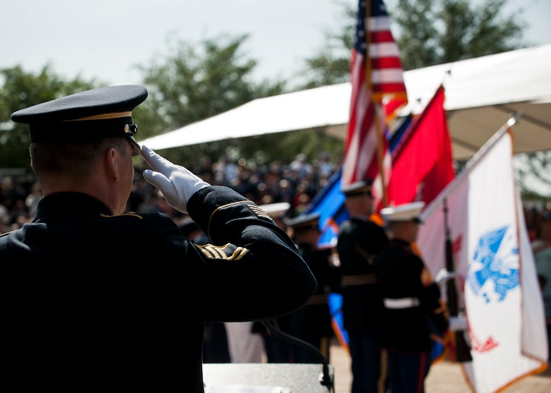 Sgt. 1st Class Joshua Peltz, the master of ceremony for the 45th Annual Explosive Ordnance Disposal Memorial Service, salutes during the presentation of the colors May 3, at Eglin Air Force Base, Fla. Eight new names of Army and Marine EOD technicians, who lost their lives, were added to the Memorial Wall this year.  The all-service total now stands at 306. (U.S. Air Force photo/Tech. Sgt. Sam King)